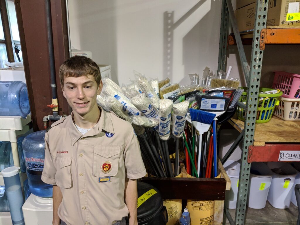 Eagle Scout Andrew with donated mops and brooms!